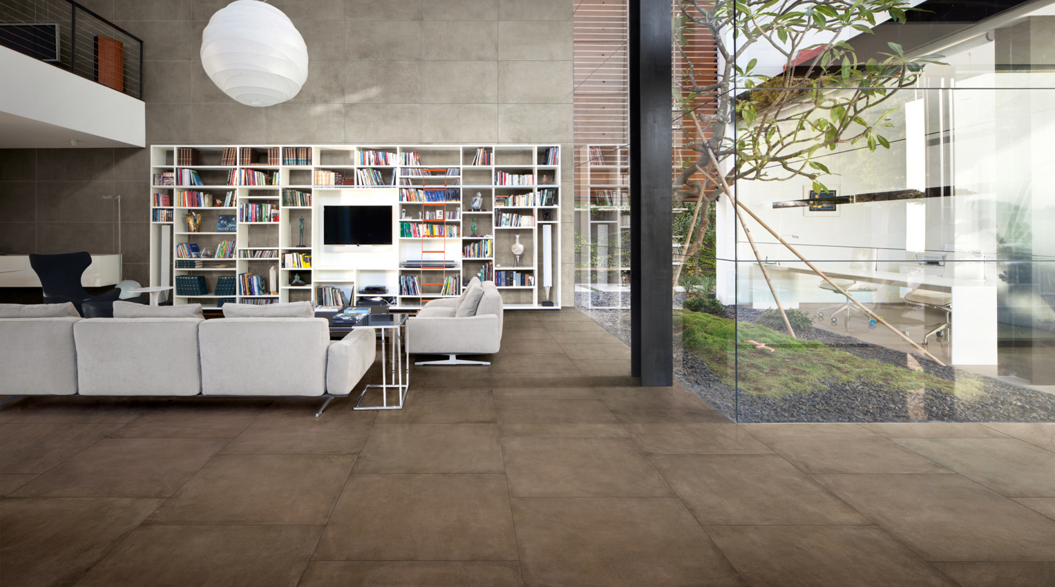 Contemporari living room with concrete look floor