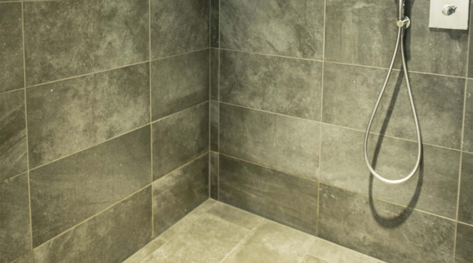 Hotel Camp Zero Stone effect tiles shower